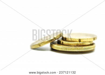 Coin pile, Mexican peso money on solid white background.