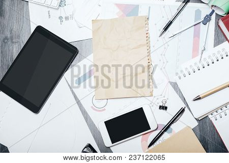 Blank Touchpad And Smartphone Place On Modern Office Tabletop With Supplies And Other Items. Mock Up