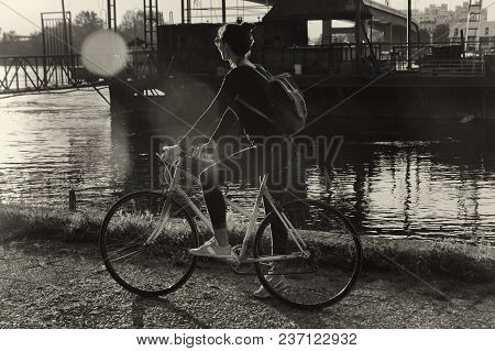 Girl Feeling Free In City Bike Ride In Sunset. Vintage Photo Of Hipster Girl On A Bike. Lifestyle Hi