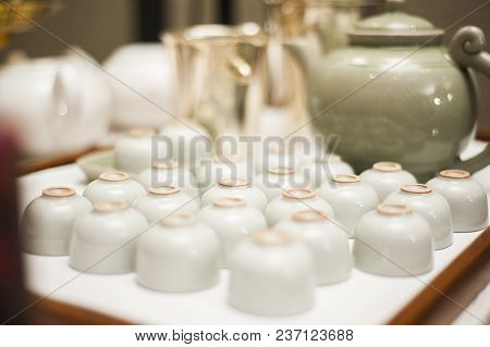 Set Of Ceramic Cup And Tea Pot In Chinese Traditional Style