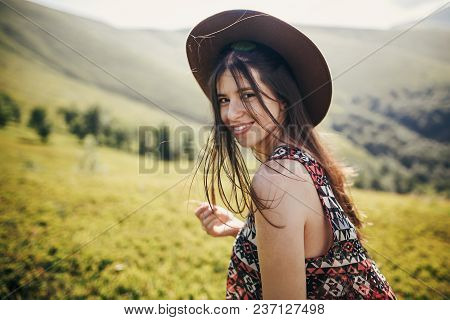 Happy Traveler Hipster Girl In Hat, Walking In Sunny Mountains. Summer Vacation. Space For Text. Hap