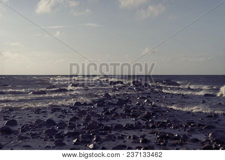 Stones On The Beach Of The Baltic Sea In The Waves Of The Storm Summer...