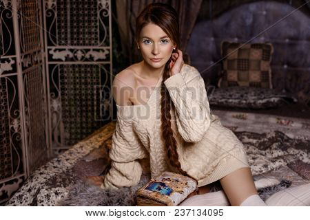 Young Girl Reading Interesting Fairy Tale In Bedroom