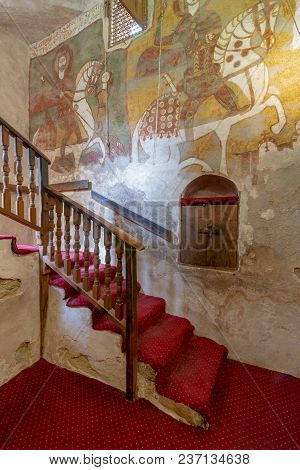 Cairo, Egypt - March 24 2018: Wall With Coptic Fresco Paintings And Staircase Leading To The Church