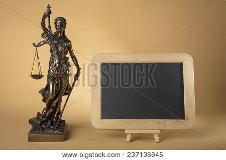 Justizia Figure With Chalkboard On Beige Background