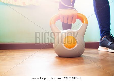 Woman Exercising With Kettlebell, Selective Focus On Hand Holding Kettlebell