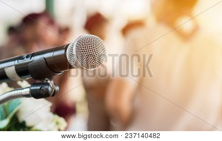 Microphones On Abstract Blurred Of Speech In Seminar Room, Speaking Conference Hall Light For Presen