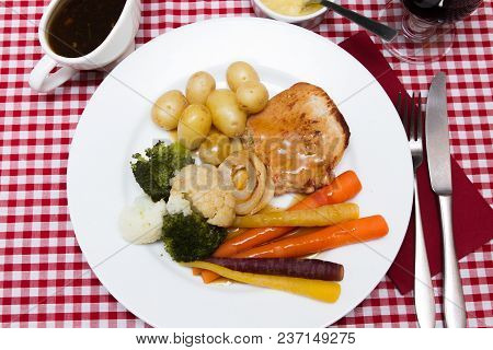 Pork Escalope  A Pork Escalope Served With Vegetables And An Apple Ring
