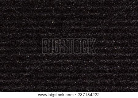 Black Paper Texture Background With Horizontal Stripes. High Resolution Photo.