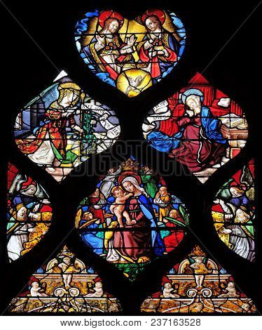 PARIS, FRANCE - JANUARY 11: Holy Trinity, Annunciation of the Virgin and Virgin with Child, stained glass window in the Saint Gervais and Saint Protais Church, Paris, France on January 11, 2018.