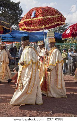 Christian Orthodox Devotees Walking Under Their Ceremonial Umbrella At The Timket Festival.