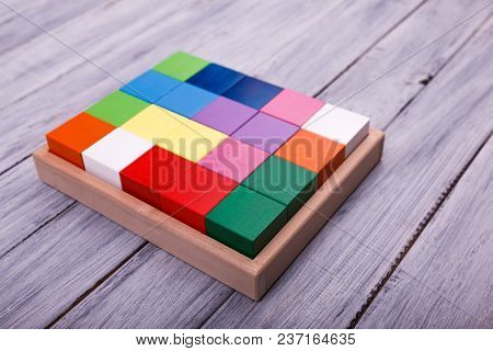Educational Games For Children. Red, Yellow, Pink, Blue Geometrical Figures On The Wooden Background