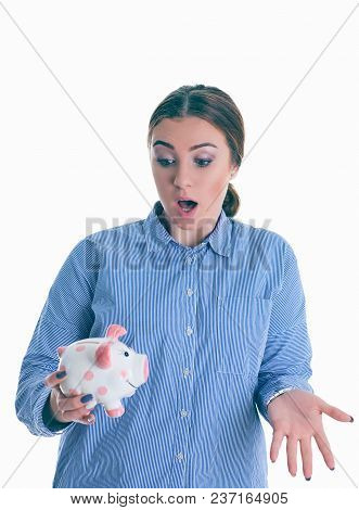 Surprised Beautiful Chef Woman Holding A Piggy Bank.