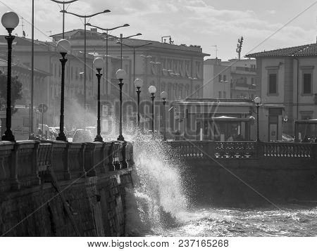 Livorno, Italy - August 2017: Sea Waves Breaking Against The Parapet Of A Road In Windy Day: Stormy