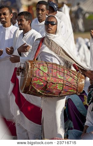 Christian Orthodox Devotees Playing A Traditional Drum At The Timket Festival.