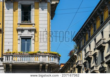 Vibrant Mediterranean Colorful Yellow Building Facade And Balcony In Milan, Lombardy, Italy