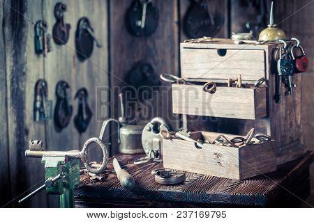 Locksmiths Workshop With Tools, Keys And Locks