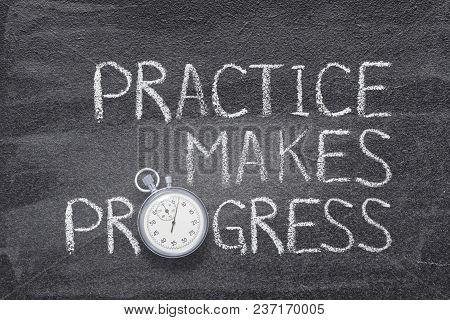 Practice Makes Progress Phrase Handwritten On Chalkboard With Vintage Precise Stopwatch Used Instead