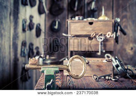 Locksmiths Workshop With Aged Tools, Locks And Keys