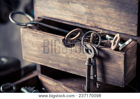 Wooden Box With Old Keys In Old Locksmiths Workshop