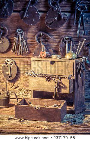Closeup Of Tools, Locks And Keys In Locksmiths Workshop