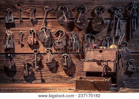 Wall Of Locks And Keys In Locksmiths Workshop