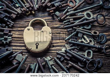 One Golden Lock And Many Old Keys As Concept