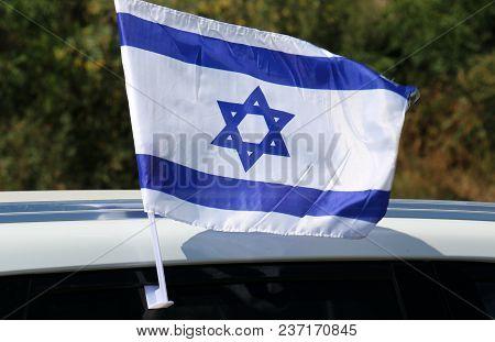 The Blue-white Israeli Flag Develops In The Wind
