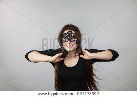Happy Pretty Mysterious Woman Wearing Black Eye Lace Mask Having Long Brown Hair.