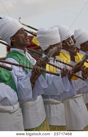 Christian Orthodox Devotees Standing In Line With Their Canes And Staffs And Singing At The Timket F