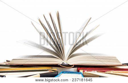 Opened Book On The Hardback Books. Isolated On White.