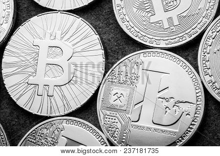 Bitcoin And Litecoin Go To The Exchange Ico Initial Coin Offering. Cryptocurrencies At Dark Backgrou