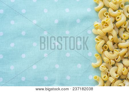 Raw Cavatappi Beautiful Decomposed Pasta With The Right, From The Side To The Green Peas Texture. Cl