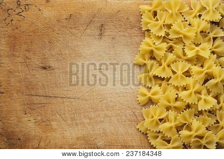 Farfalle Raw Farfallini Beautiful Laid Out Pasta With The Right, Side On A Wooden Plank Texture Back