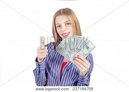 Beautiful Girl Holding A Fan Of Dollar Bills. Photo Isolated On White Background.