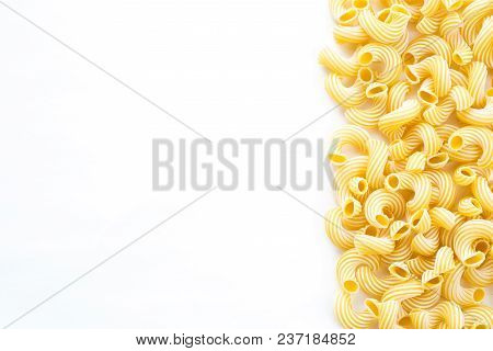 Raw Cavatappi Beautiful Laid Out Pasta With The Right, With A Side On White Isolated Background. Clo
