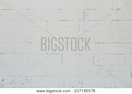 Wall Of Large White Brick With Small Cracks