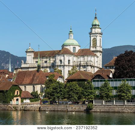 Buildings Of The Historic Part Of The City Of Solothurn Along The Aare River, Towers Of The Famous S