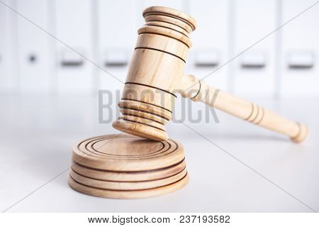 Wooden Gavel And Folders On Wooden Table, Close Up.