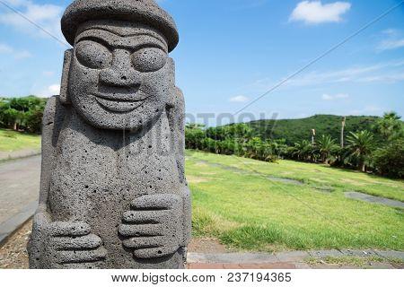 Yongmeori Beach, Sanbang-ro, Jeju Island, South Korea - August 28 2017: Dol Harubang Statue In Green