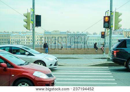 St. Petersburg, Russia - April, 17, 2018: traffic on an embankment of Neva river in St. Petersburg