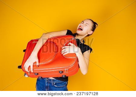 Emotional Young Girl Holding A Heavy Big Suitcase, Going On Vacation