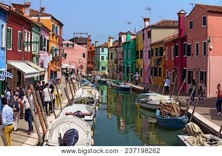 Burano, Venice/italy - April 16, 2018: Street With An Unidentified People, Colorful Houses, Canal An