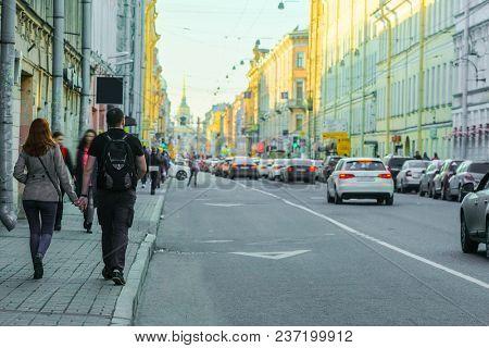 People go down the street in St. Petersburg