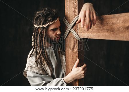 Jesus Christ with crucifixion on black background
