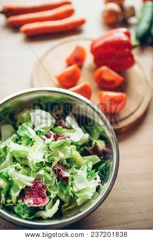 Vegetables and salad on wooden table, nobody