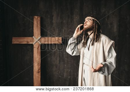 Jesus Christ talking to God by mobile phone