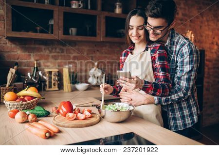 Love couple prepares romantic dinner on kitchen