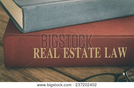 Law Concept, Real Estate Law Books, Antiquarian Books Pile On Wood Table.