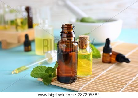 Bottles With Essential Oils On Bamboo Mat